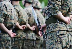 Soldiers with military camouflage Stock Images