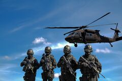 Soldiers and military helicopter Royalty Free Stock Image