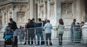 Soldiers monitor and control tourists at the entrance of Milan C. Milan, Italy - November 03, 2017 : soldiers monitor and control tourists at the entrance of stock photography