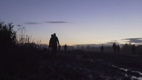 Soldiers are on the muddy field at sunset. Military night. Soldiers are on the muddy field at sunset. Military night stock video footage