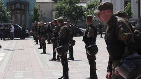 Soldiers of the National Guard of Ukraine on the streets of Kyiv. Soldier of the National Guard of Ukraine on the streets of Kyiv. Stock video footage HD / 1920 stock footage