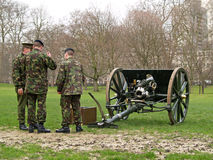 Soldiers by an old war gun. British Soldiers by an old war gun stock photography