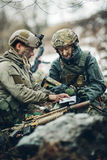 Soldiers on the Outdoor of looking at the map. Rangers on the Outdoor of looking at the map Royalty Free Stock Image