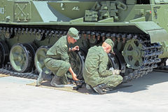 The soldiers paint military equipment Stock Photo