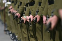 Soldiers on parade. Line of New Zealand Army Soldiers with bayonets fixed, standing at ease Royalty Free Stock Images