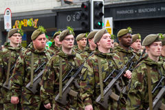 Soldiers in a parade for St. Patrick's Day. LIMERICK, IRELAND - MARCH 17:  Unidentified soldiers of Irish army participate in a parade for St. Patrick's Day. It' Royalty Free Stock Images