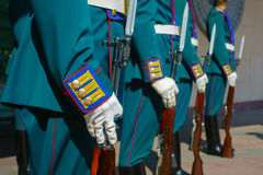 Soldiers in parade uniform with rifles Stock Images
