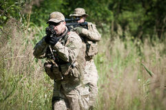Soldiers on patrol aiming Stock Image