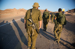 Soldiers patrol in desert Royalty Free Stock Photo