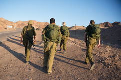 Soldiers patrol in desert Stock Image