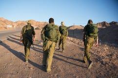 Soldiers patrol in desert stock image