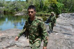 Soldiers patrol on the mountain river. stock photo