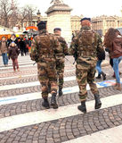 Soldiers patrol Paris' streets Stock Photo