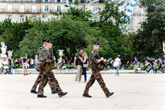 Soldiers patrolling in Paris Stock Images