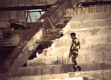 Soldiers patrols the area on a destroyed building. royalty free stock photography