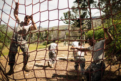 Soldiers performing training exercise on net Royalty Free Stock Photo