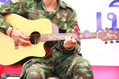 Soldiers playing guitar Royalty Free Stock Photography