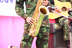 Soldiers playing saxophone Stock Photo