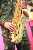 Soldiers playing saxophone Royalty Free Stock Image