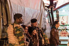 Soldiers posing with visitors in Brussels Stock Photography