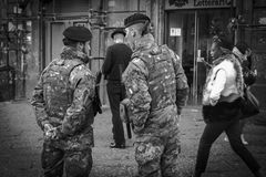 Soldiers protect tourists from terrorist attacks. Naples , Italy December 2017: soldiers protect tourists from terrorist attacks, Piazza San Domenico tourist royalty free stock photos