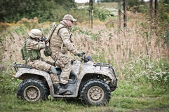 Soldiers on quad Royalty Free Stock Photos