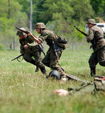 Soldiers race into battle stock images