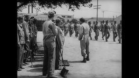 Soldiers receiving orders on work detail at training camp, 1940s stock video footage