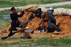 Soldiers-reenactor fights on the battle field. Stock Photography