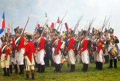 Soldiers-reenactors in red jackets Stock Image