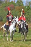 Soldiers-reenactors ride horses. Royalty Free Stock Photo