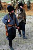 Soldiers-reenactors walk on the battle field. Stock Images