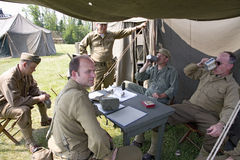 Soldiers relax in front of tent, Stock Photos
