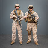 Soldiers with rifle posing at Militalia in Milan, Italy Royalty Free Stock Images