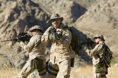 Soldiers With Rifles On Mission stock photography