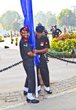Soldiers rise the flag at the India Gate monumen Stock Photography