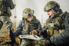 Soldiers in the room looking at the map Stock Image