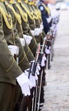 Soldiers in a row. Uniformed soldiers standing in a row stock photography