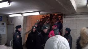 Soldiers of the Russian interior troops in winter clothes down in the subway stock footage