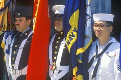 Soldiers and Sailor Holding Flags Stock Image