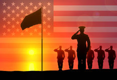 Soldiers salute the flag raising. Stock Photos