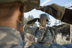 Soldiers saluting Royalty Free Stock Image