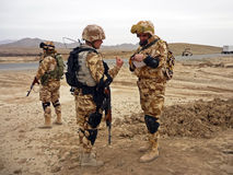 Soldiers searching the area around a village in Afghanistan royalty free stock image