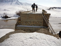 Soldiers searching a bridge in Afghanistan Royalty Free Stock Image