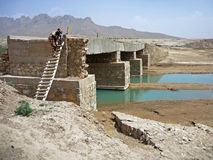 Soldiers searching a bridge in Afghanistan Stock Photography