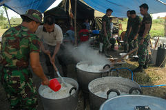 Soldiers set up a soup kitchen Royalty Free Stock Photo