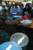 Soldiers set up a soup kitchen Stock Photos
