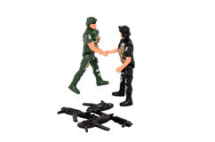 The soldiers shake hands. Soldiers handshaking isolated on white. Disarmament, a truce, not war. A toys Stock Photos