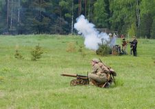 Soldiers shooting of Maxim machine gun Royalty Free Stock Photography