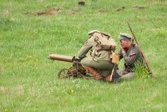 Soldiers shooting of Maxim machine gun Royalty Free Stock Image